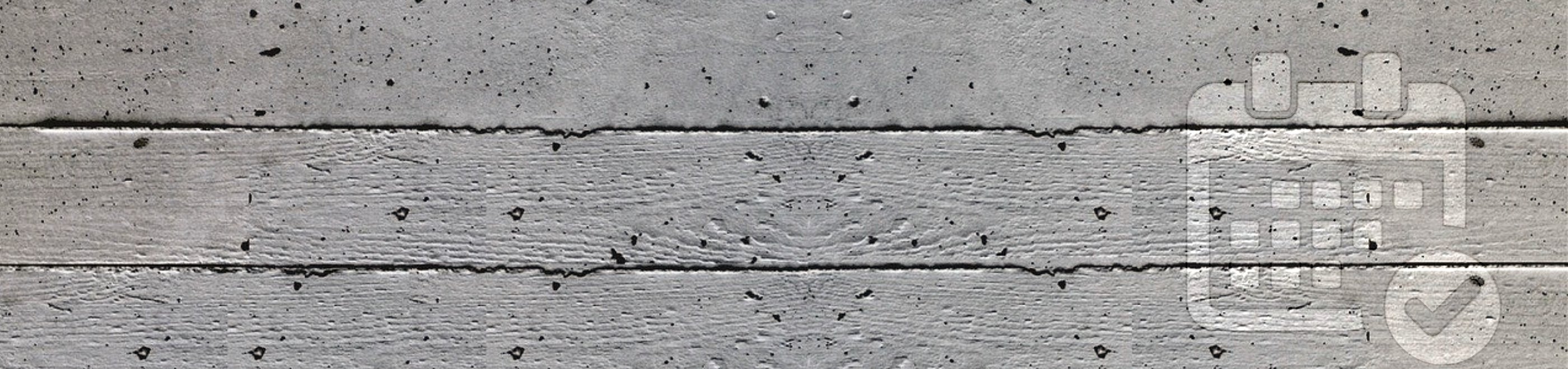 Grey concrete wall with pores and horizontal grooves.